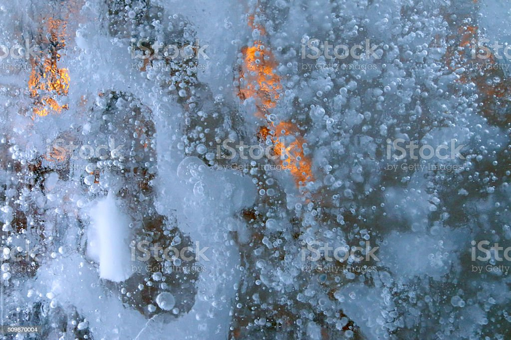 Closeup large piece of ice with beautiful white bubbles stock photo