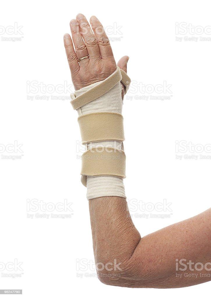 Close-up left arm in wrist brace stock photo
