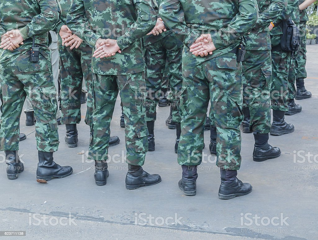 Closeup legs of soldiers in uniforms stock photo