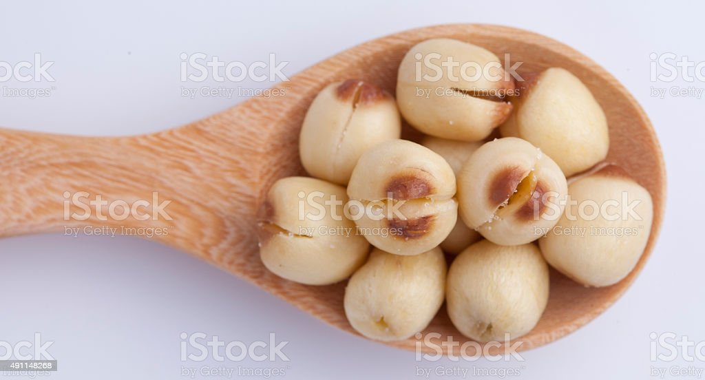 close-up lotus seed in wooden spoon stock photo