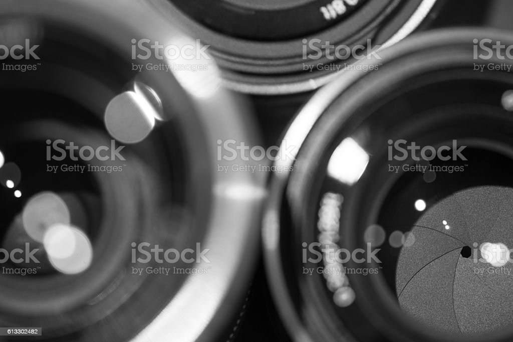 closeup macro of camera lenses with reflections low key image stock photo