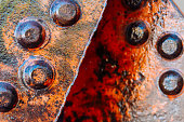 Close-up macro of iron rivets on a rusted iron beam