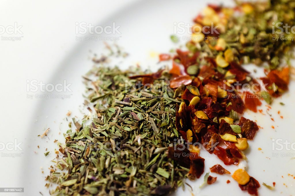 Closeup Macro of Seasoning Spices on a plate stock photo