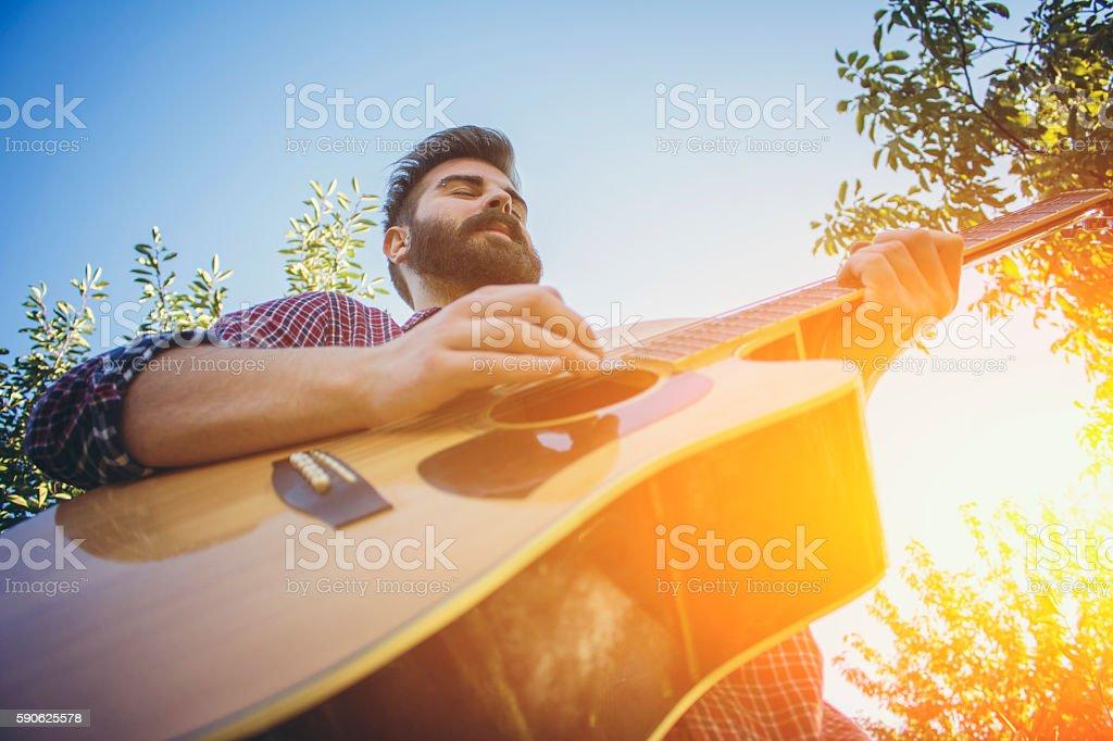 Closeup, man playing acoustic guitar stock photo