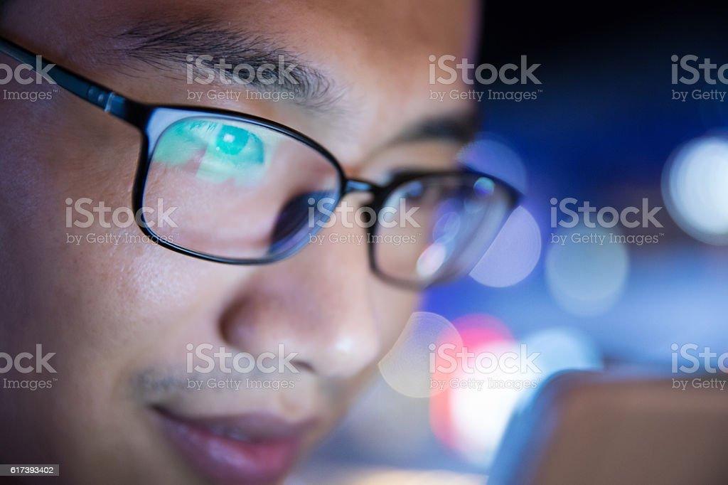 close-up man using mobile phone at night stock photo