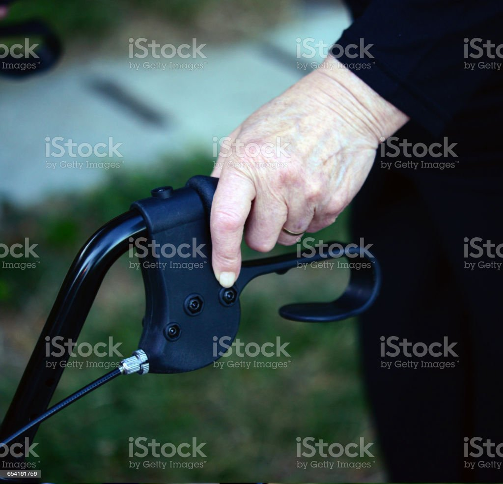 Closeup midsection of a senior woman using walking frame stock photo