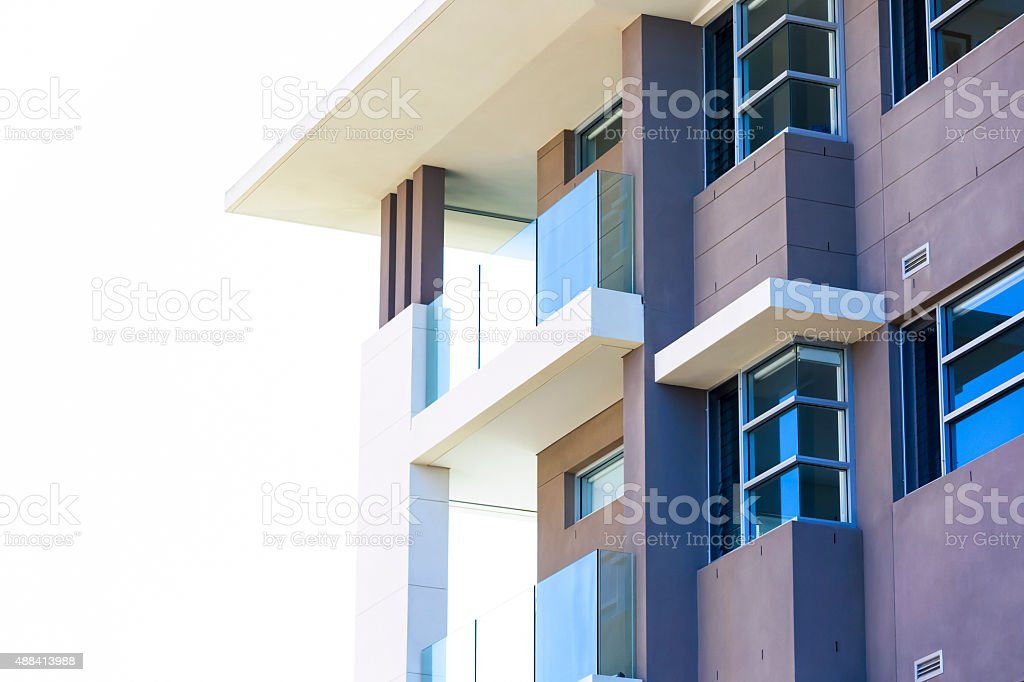 Closeup modern apartment building against white background,copy space stock photo