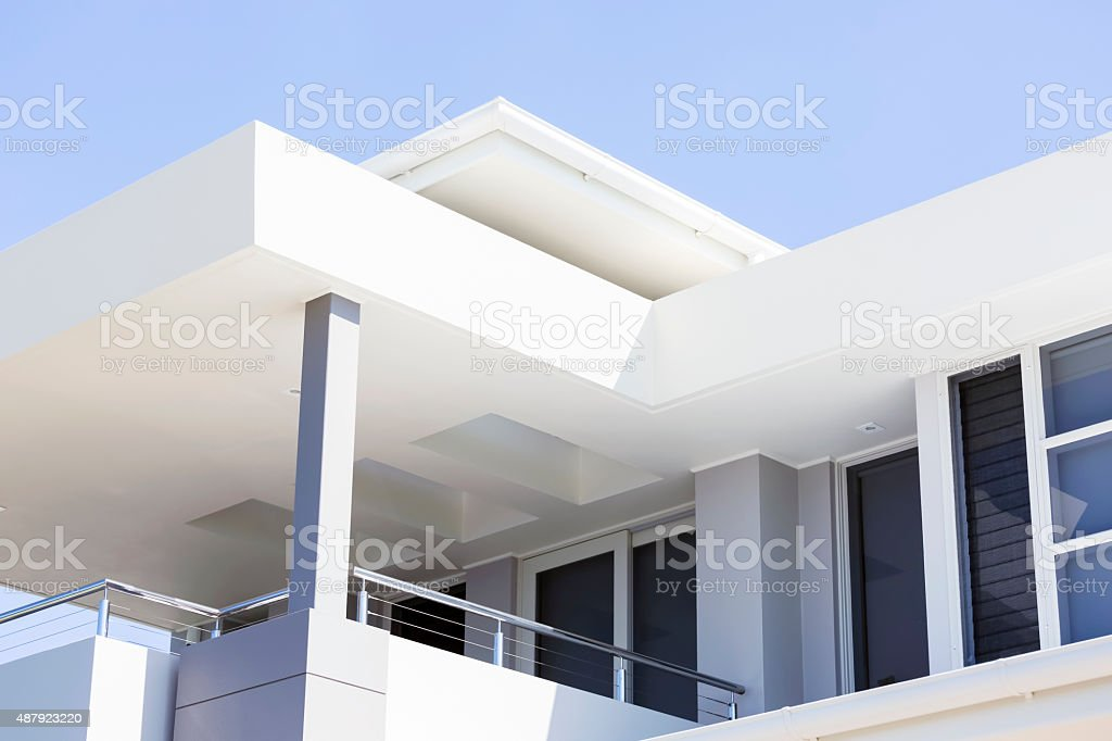 Closeup modern contemporary house with white render, copy space stock photo