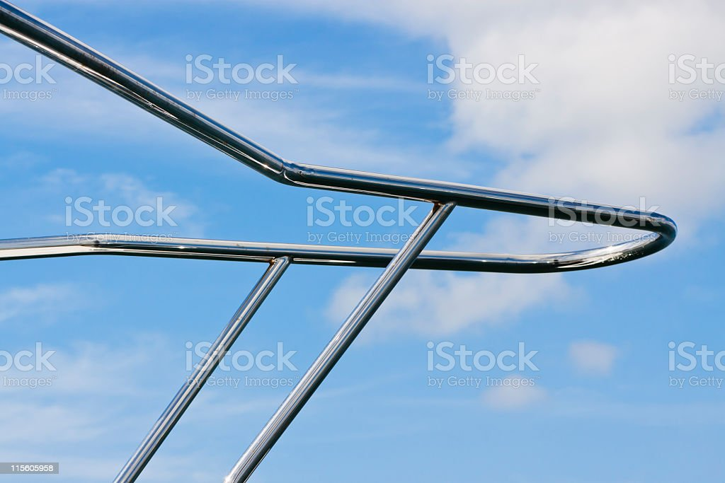 Closeup motor yacht railing against blue sky, copy space royalty-free stock photo