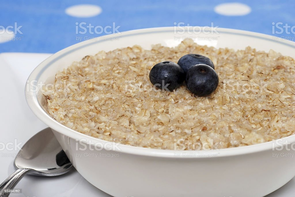 closeup oatmeal with blueberries focus on berries royalty-free stock photo