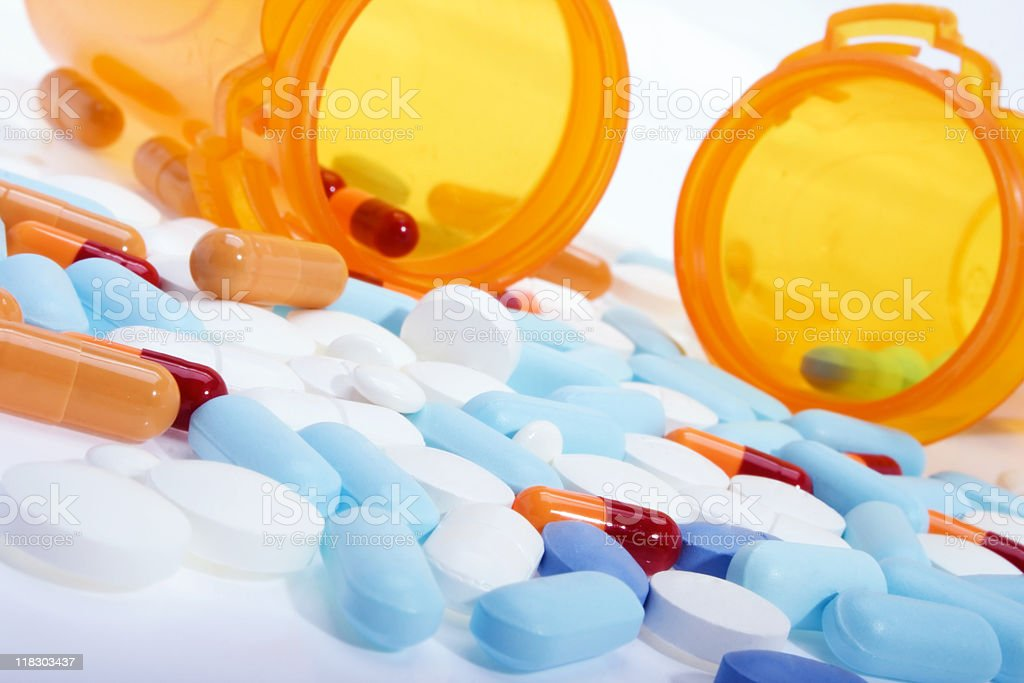 Close-up of 2 bottles of prescription drugs spilled on table stock photo
