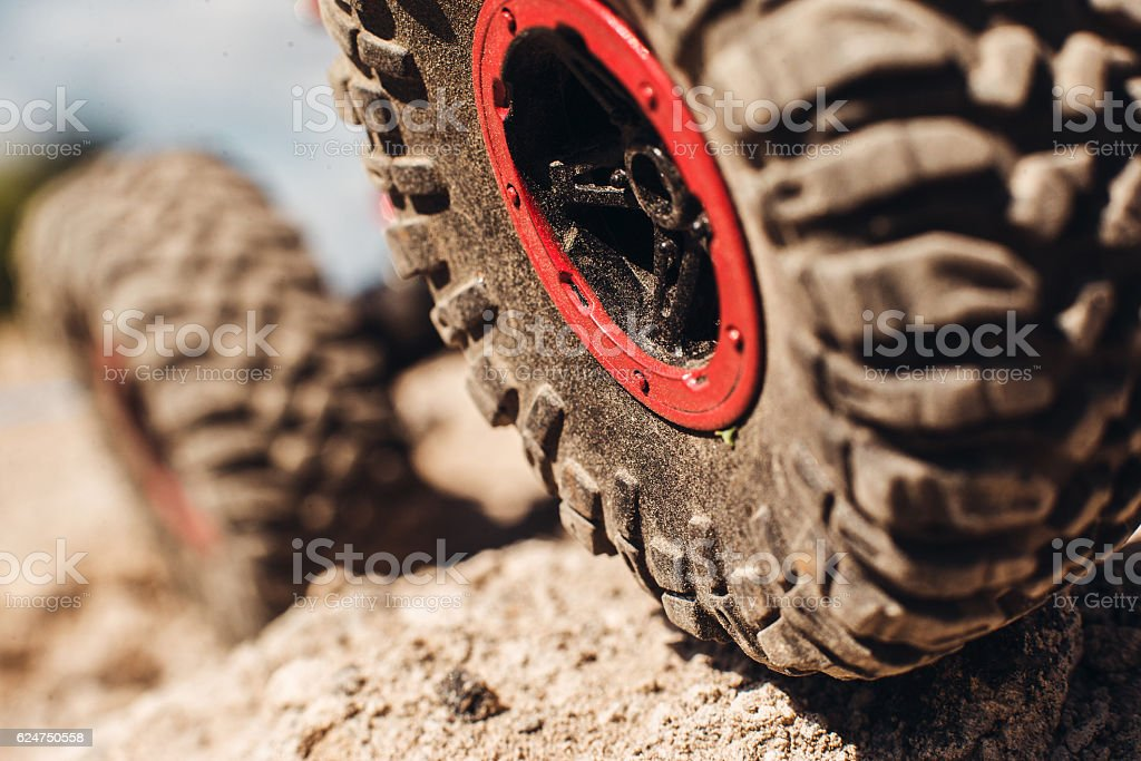 Closeup of 4x4 truck tire on rock track stock photo