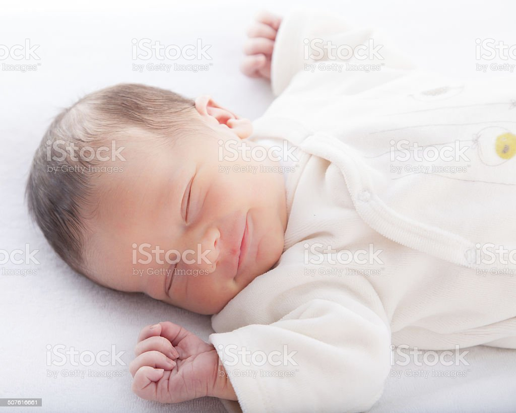 Close-up of a baby boy sleeping stock photo