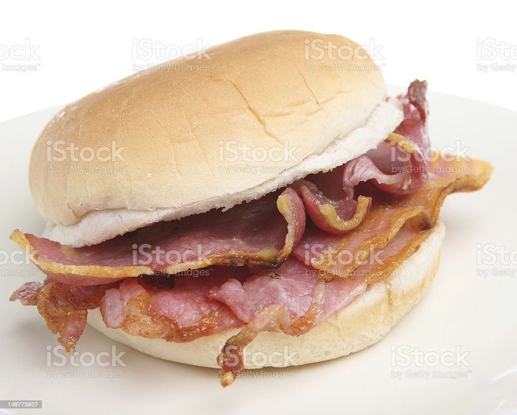 Close-up of a bacon breakfast sandwich on a bun on white stock photo