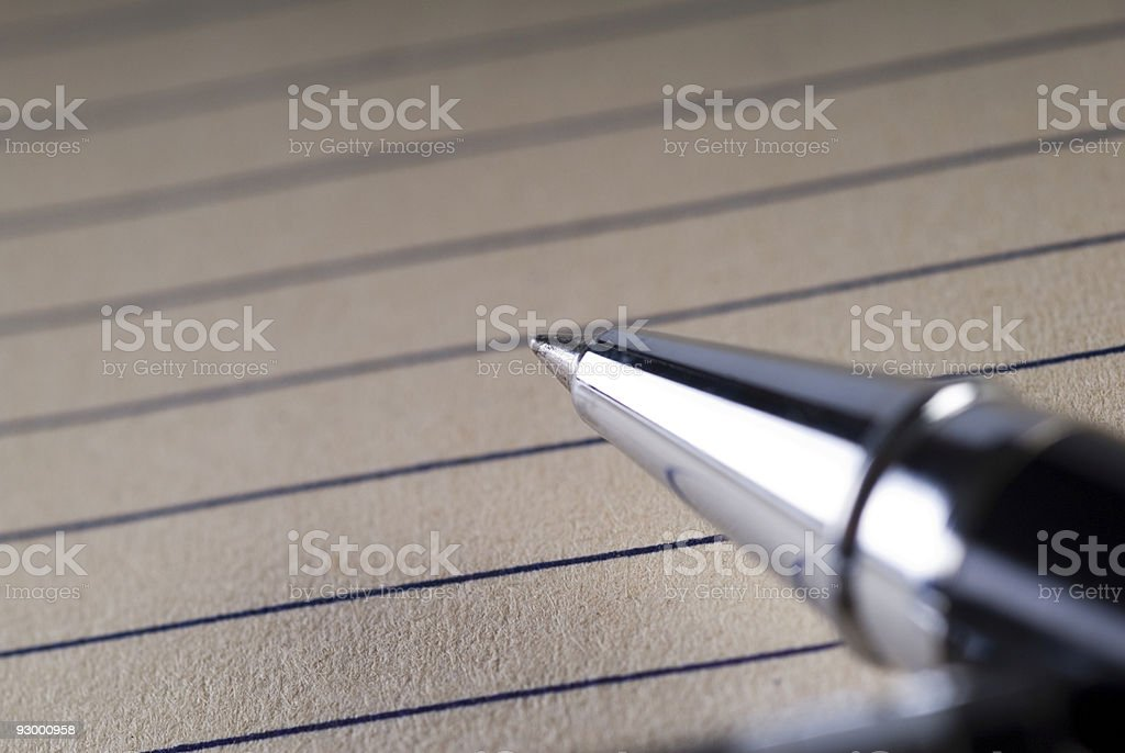 Close-up of a ballpoint pen on paper royalty-free stock photo