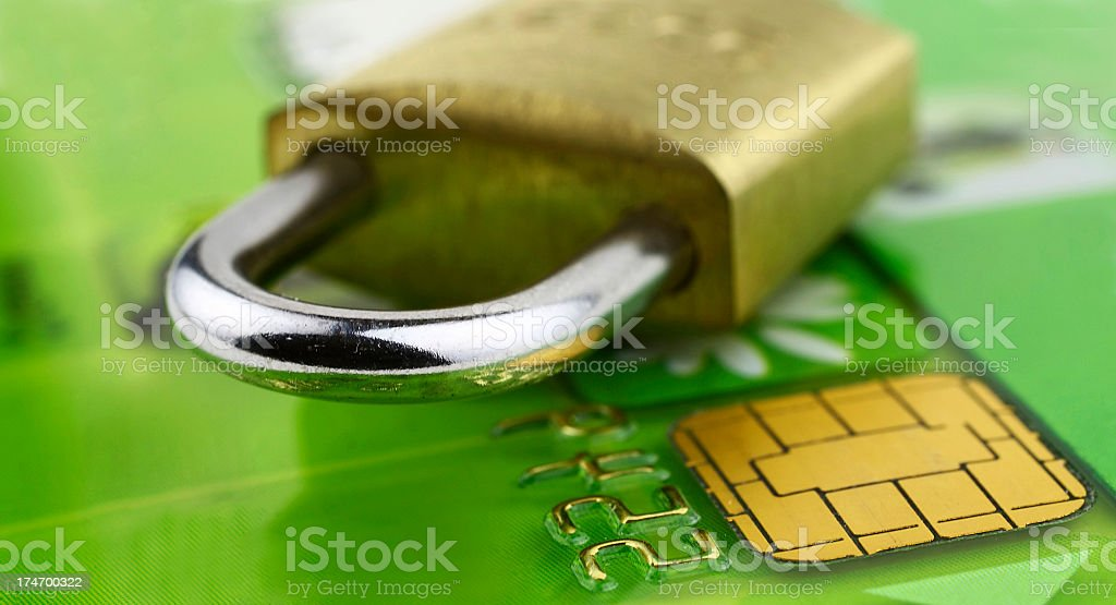 A close-up of a bank chip card with a lock on it royalty-free stock photo