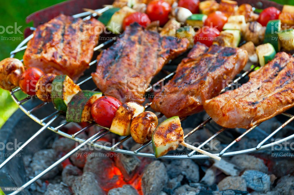 Close-up of a barbecue grill with grilled food stock photo