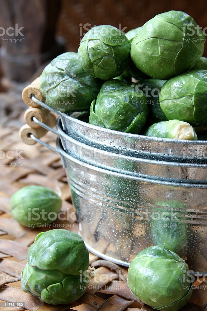 Close-up of a basin overflowing with Brussels sprouts stock photo
