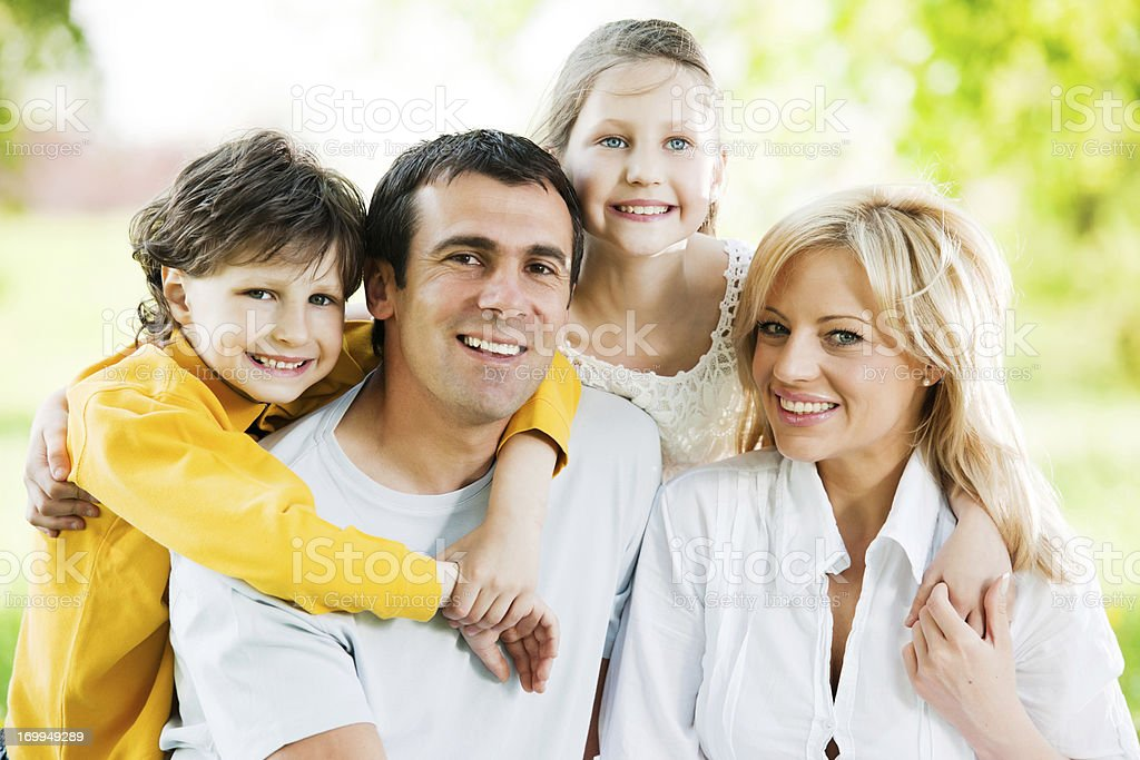 Close-up of a beautiful embraced family. royalty-free stock photo