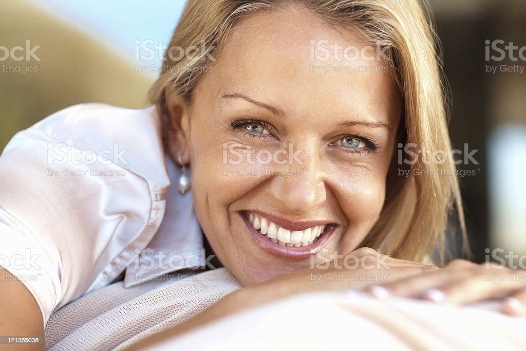Closeup of a beautiful, happy, mature woman smiling royalty-free stock photo