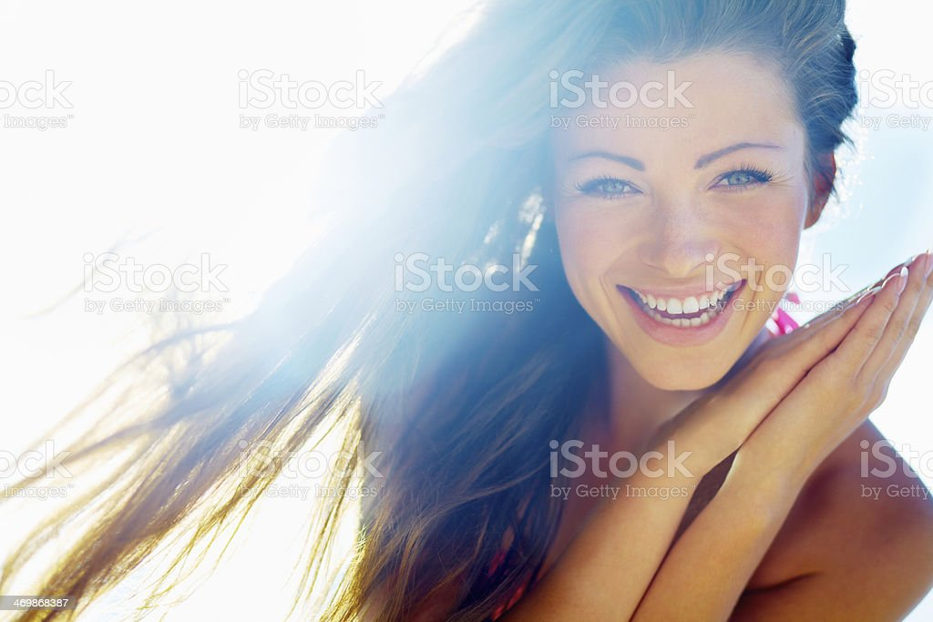 Closeup of a beautiful smiling young woman stock photo