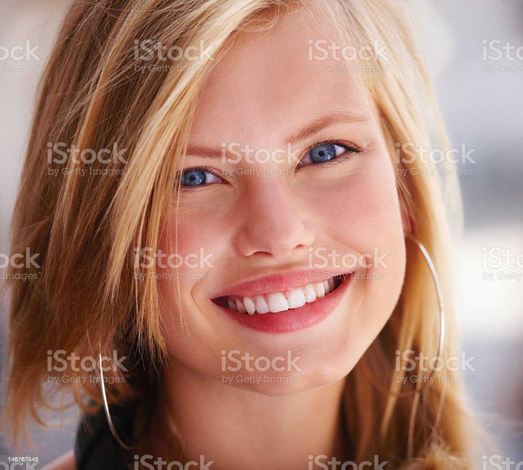 Close-up of a beautiful teenage girl smiling royalty-free stock photo