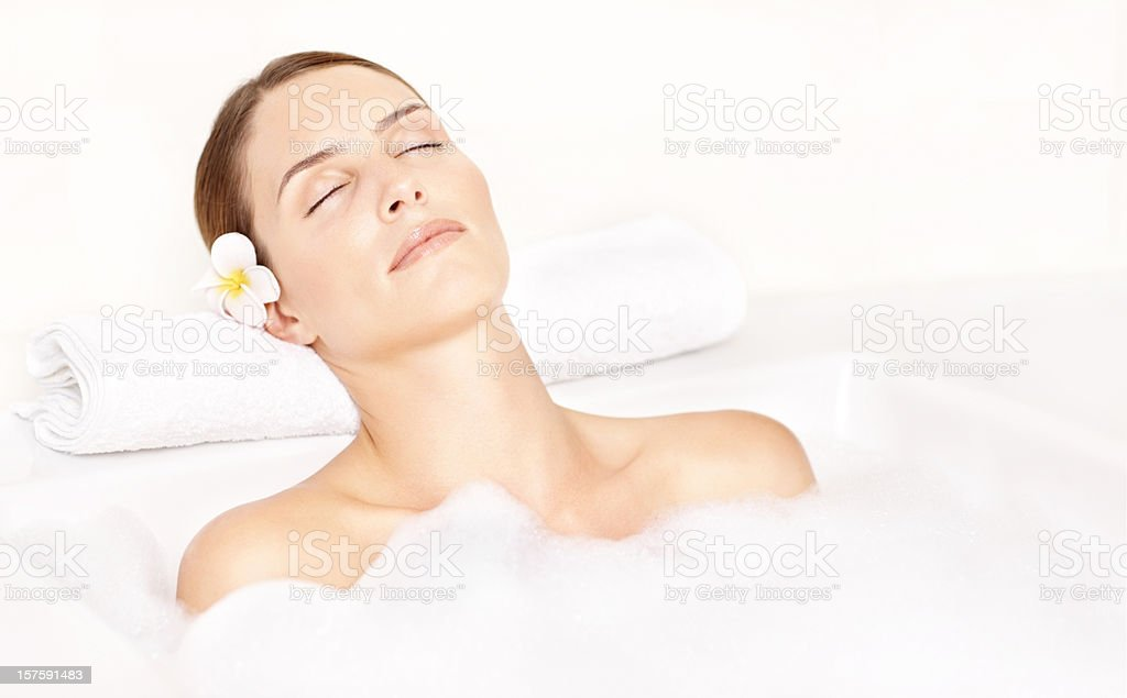 Close-up of a beautiful woman relaxing in bath tub royalty-free stock photo