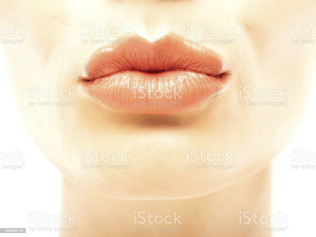 Closeup of a beautiful woman's full puckered lips royalty-free stock photo
