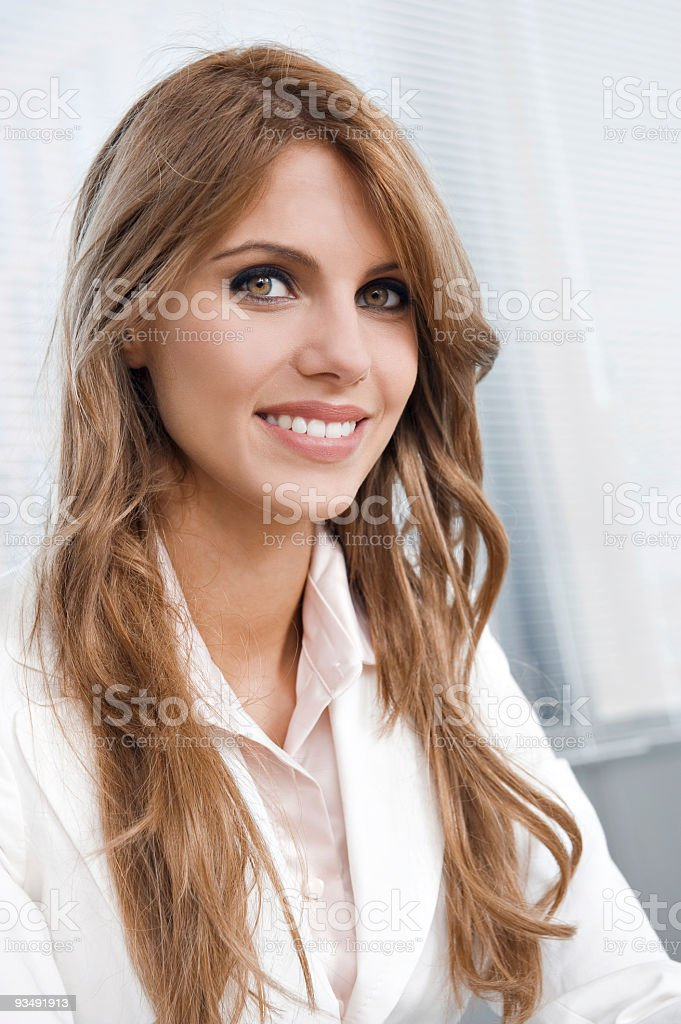 Close-up of a beautiful young businesswoman smiling stock photo