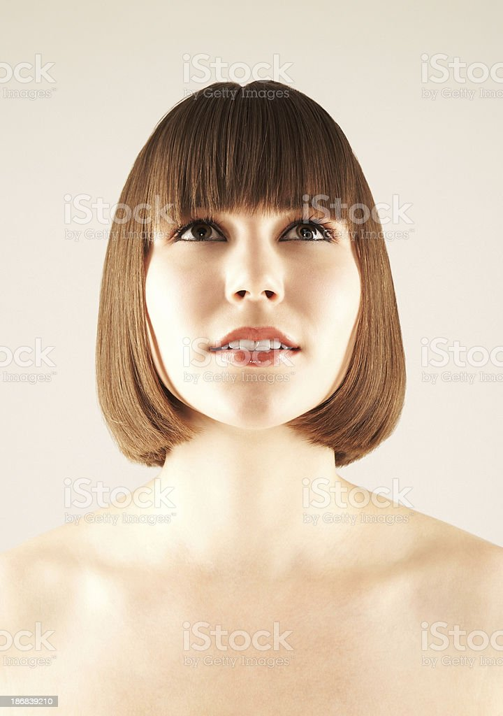 Close-up of a beautiful young girl looking up royalty-free stock photo