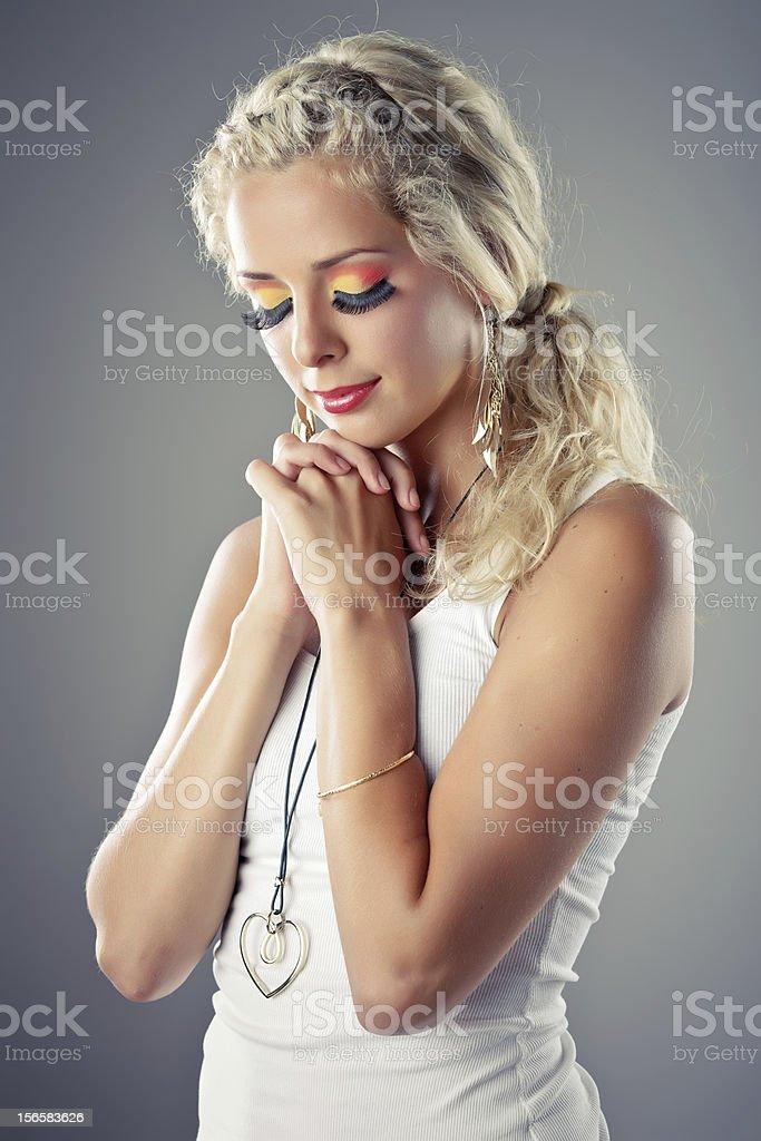 Close-up of a beautiful young woman praying royalty-free stock photo