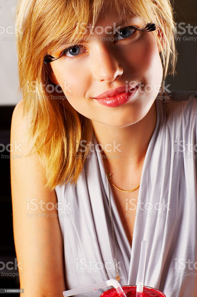 Close-up of a beautiful young woman smiling royalty-free stock photo