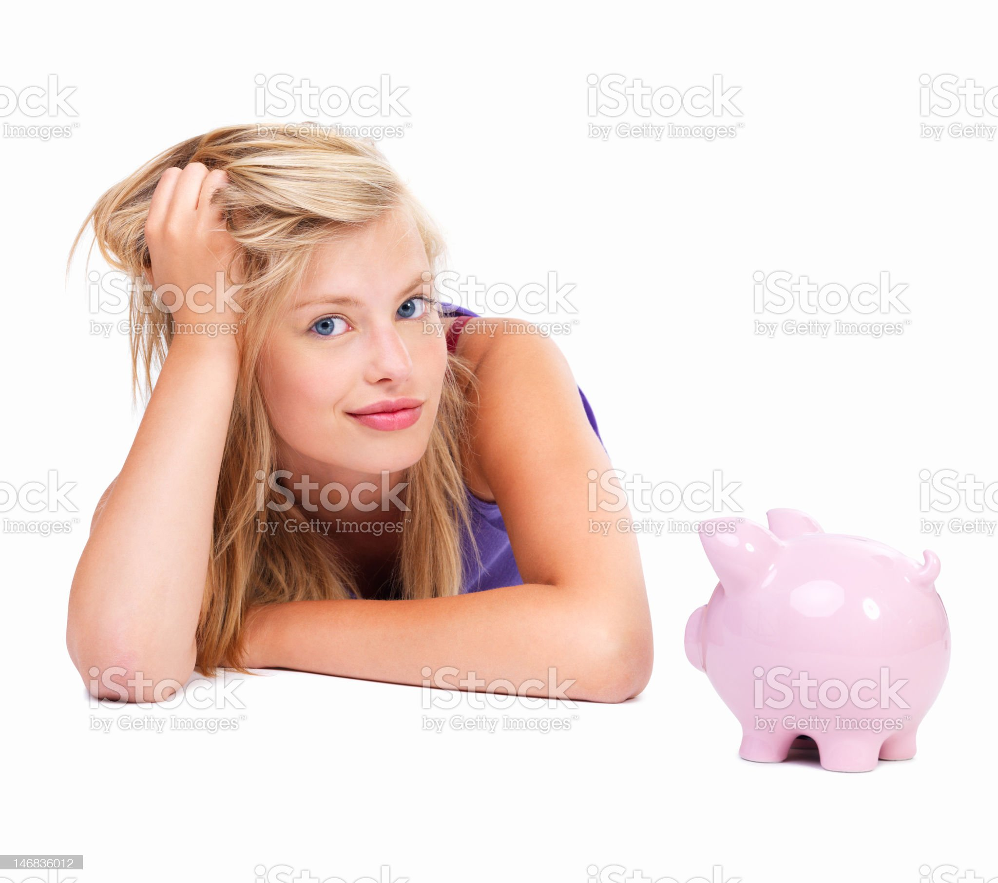 Close-up of a beautiful young woman with piggy bank royalty-free stock photo