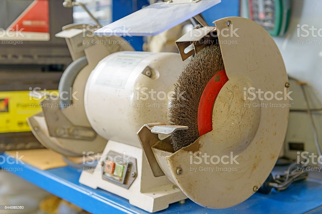 closeup of a bench grinder stock photo