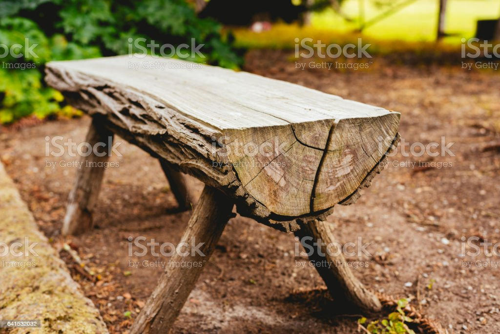 Close-up of a bench made of trunks in the garden stock photo