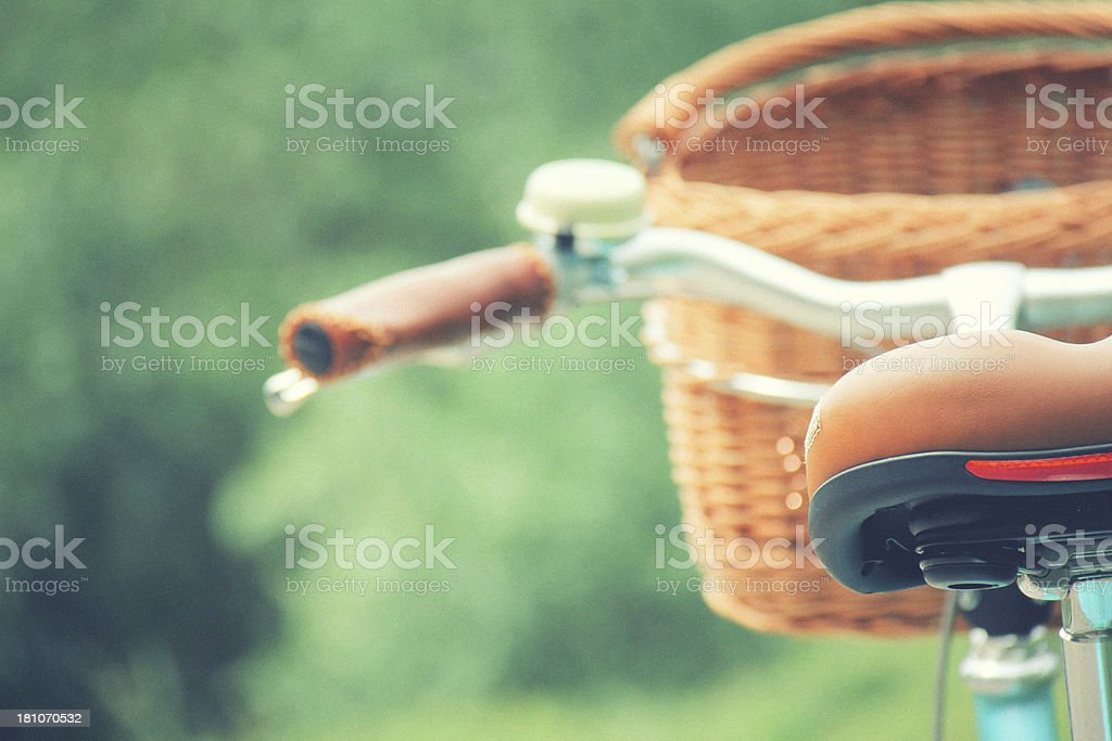 Close-up of a bicycle with basket and blurry background stock photo