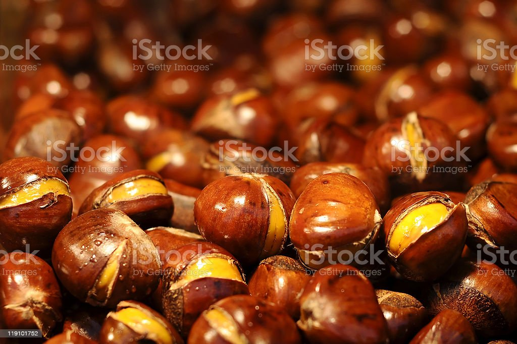 Close-up of a big pile of roasted chestnuts royalty-free stock photo