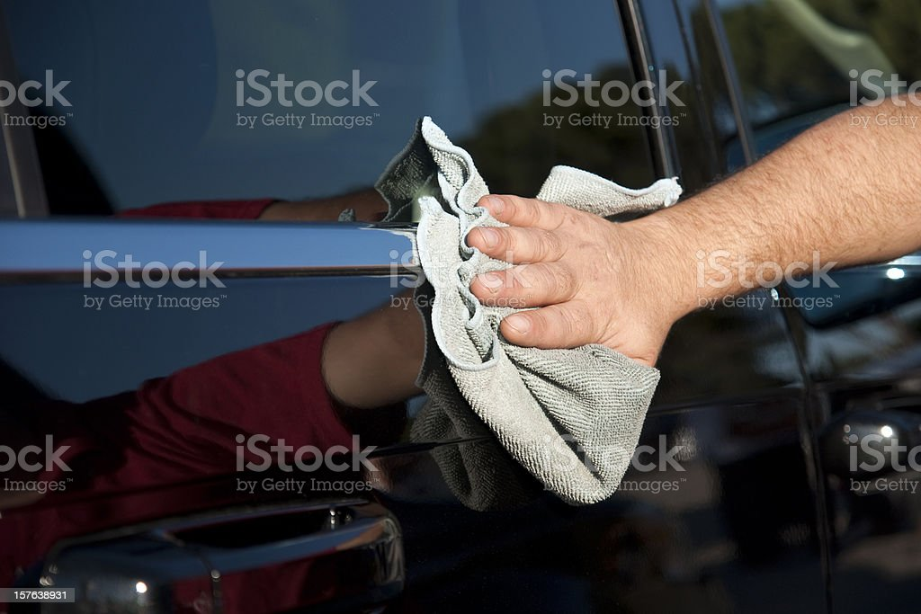 Closeup of a black car being polished stock photo