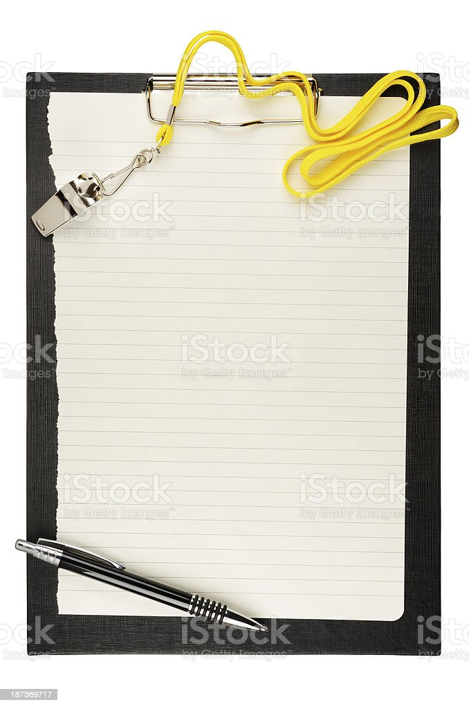 A close-up of a blank clipboard with a silver whistle stock photo