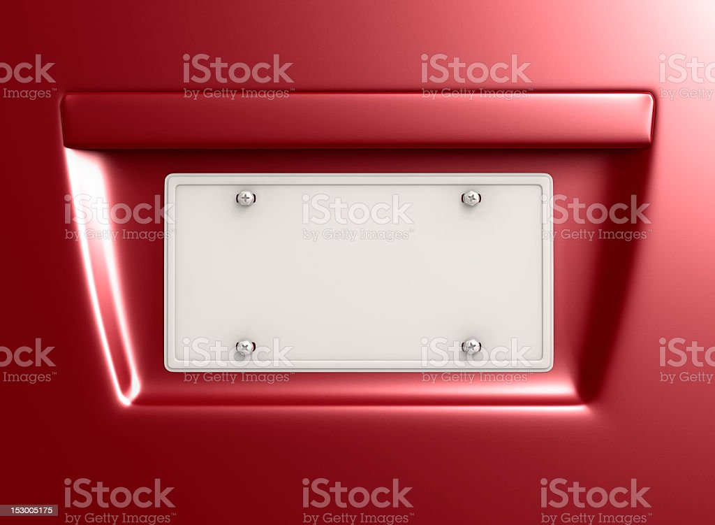 Close-up of a blank license plate on a red vehicle stock photo
