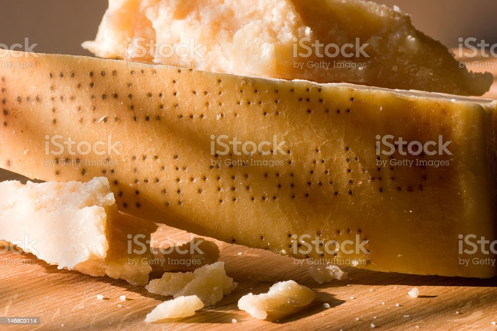 Close-up of a block of parmigiano reggiano cheese stock photo