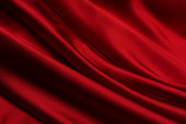 Close-up of a blood red satin fabric