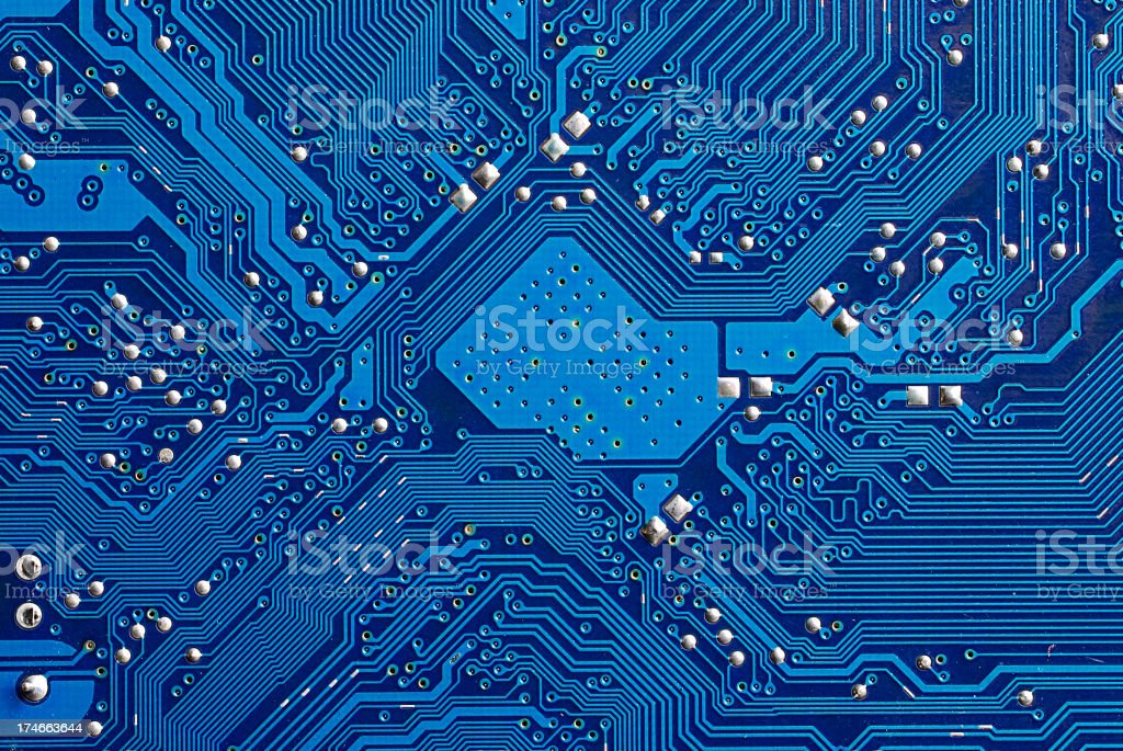 Closeup of a blue computer circuit board stock photo
