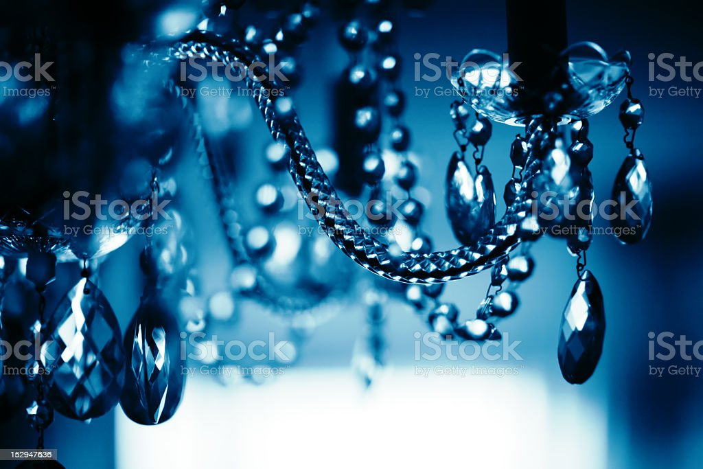 Close-up of a blue-toned crystal chandelier stock photo