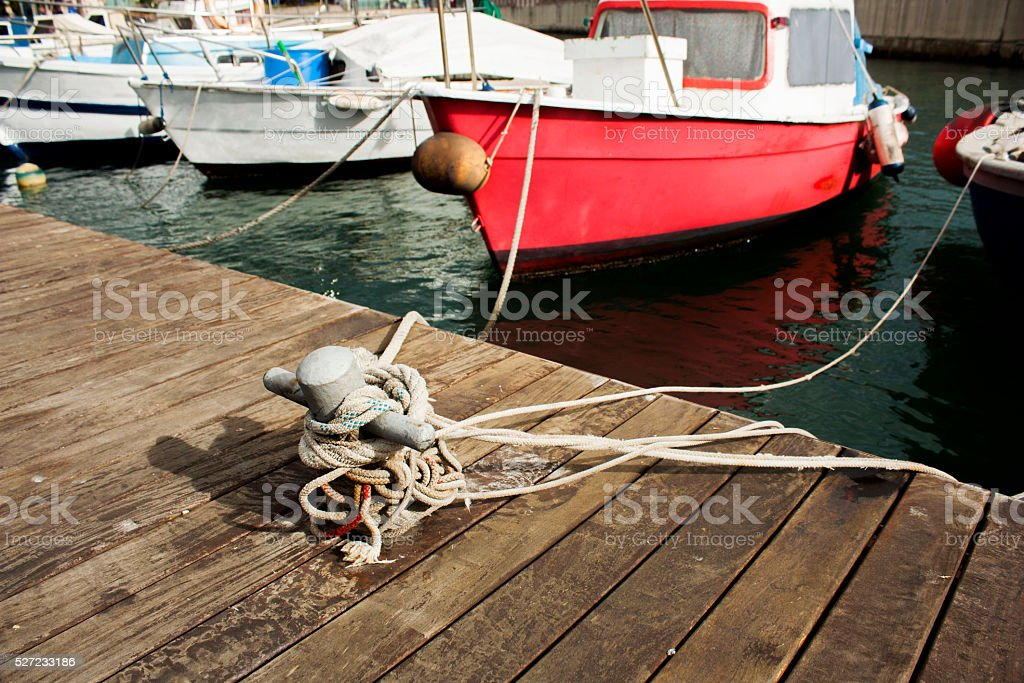 closeup of a boat tied with a rope stock photo
