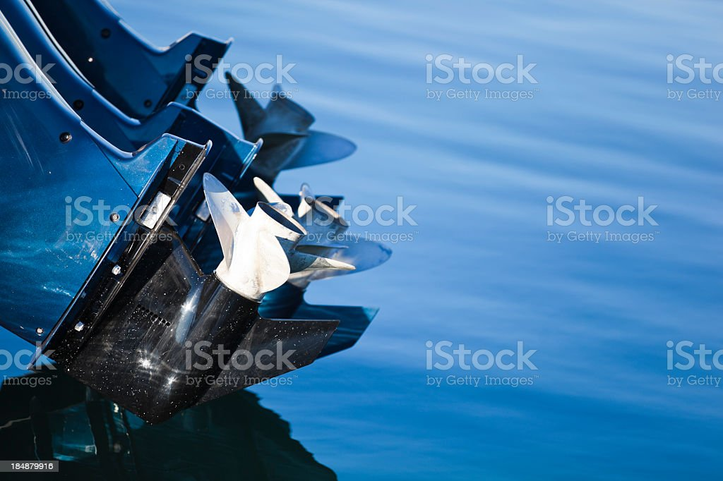 Close-up of a boat's outboard motor and propellers stock photo