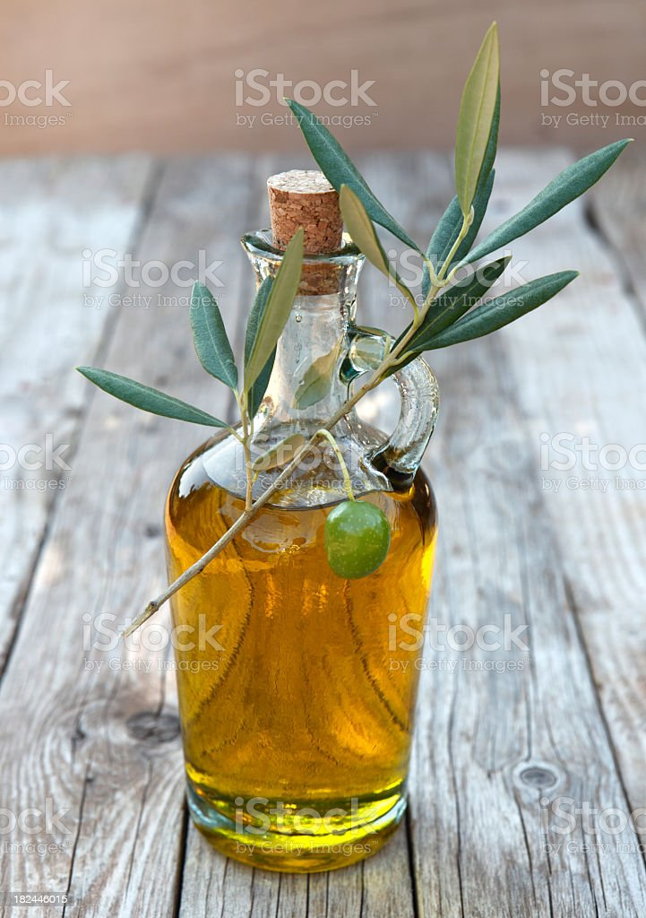 Close-up of a bottle of olive oil stock photo