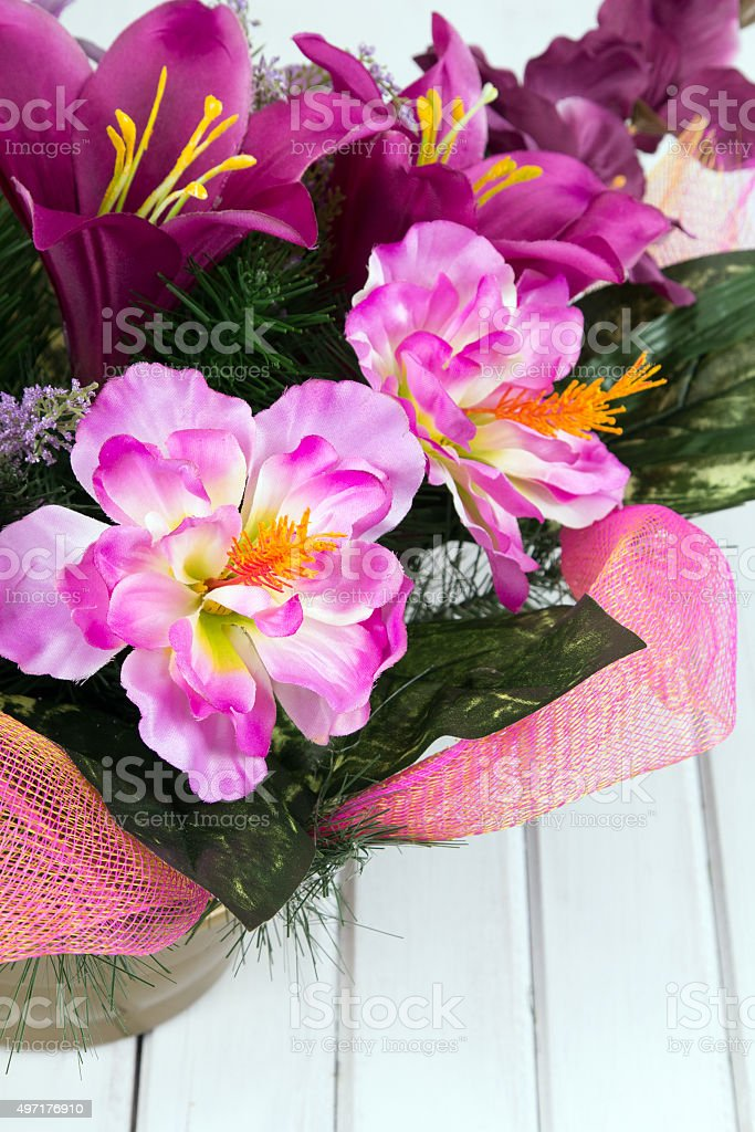 closeup of a bouquet of artificial flowers stock photo