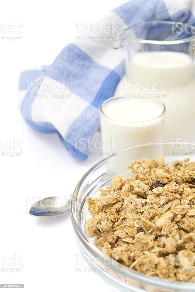 Close-up of a bowl cereal with jug fresh milk royalty-free stock photo