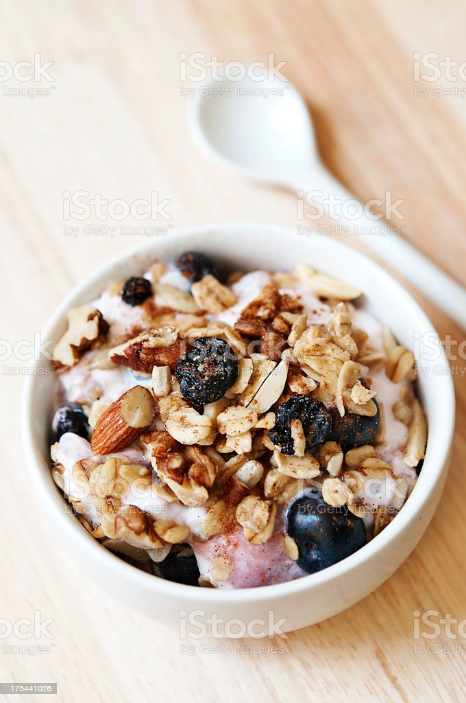 Close-up of a bowl of granola cereal with spoon stock photo